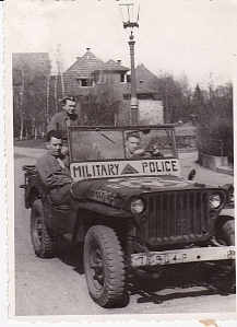 This one is clearly labeled 7th Army. Markings on the jeep verify that. My dad wrote on the back, Meade, Meadows and me. Dad is in the back seat. I speculate that Meade is the driver. I'm thinking it's an off duty picture given the lack of helmets and patrol gear.