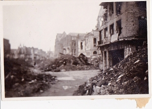 "Writing on the back of this one reads, ""busy section of Cologne proper."" Dating would be winter\spring, 1946. Barely enough room through the rubble for a jeep or truck to get through. Dad said many of the Germans were employed removing the rubble, mostly by hand."