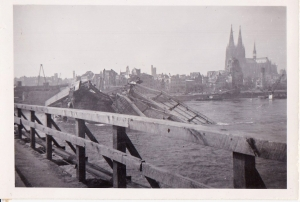 "This one reads, ""Cologne Bridge (kaput) Cathedral in background. The aerial photo above clearly shows the same bridge destroyed. The bridge would have been a bombing target."