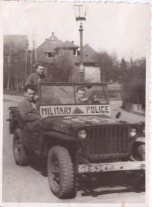 My dad is in the back of the jeep. The jeep's markings indicate 7th Army. His unit was transferred to the 5th Army at some point.
