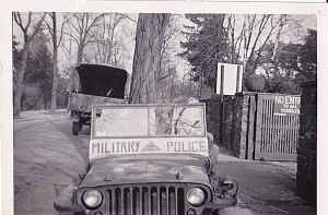 "This picture says ""taken at the Belgian Red Cross"" although it is one of the pictures on a different type of photo paper. Nice shot of the front of the MP jeep!"