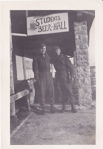 Dad and an unnamed friend outside of a beer hall.