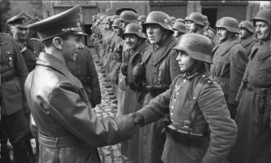 "I am uncertain if the soldiers in this picture are ""Volksturm"" or regular Wehrmacht, although the age of the soldiers illustrate the typical composition of Volkstrum, old men and boys. Goebbels made much of the Nemmorsdorf Massacre and expected these men and boys to die defending East Prussia."