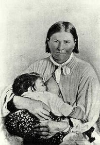 "The best known picture of Cynthia Ann Parker and her toddler daughter Prairie Flower at her breast-a highly usual picture for the 1860's when it was taken. A ""white"" woman would never have been pictured like this. Even though Cynthia was white she clearly looks Comanche. Prarie Flower wold die a few years later of disease devastating Cynthia and her last link to her Comanche way of life."