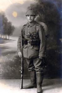 """Young German soldier wearing the distinctive """"pickelhaube"""" helmet, 1914-16."""
