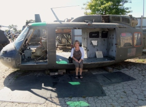 My wife sitting in the door of a cannibalized Huey. The museum has quite a few Hueys most of which are in poor condition. Some are for sale. The Huey is most identified with the Vietnam War. It has been replaced in the US Military but still serves around the world in many capacities.
