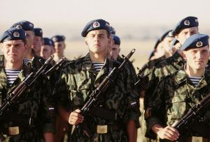 Russian paratroops wear a distinctive blue and white striped under garment.