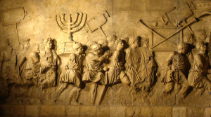 Arch of Titus. The Menorah is one of the spoils of war. http://en.wikipedia.org/wiki/Second_Temple