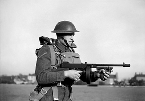"British soldier using the drum version of the famous Thompson. This weapon would give the ""government"" forces the edge in the battle."