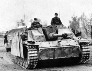 The Stug III was built off the chassis of a Panzer III.   There are six return rollers on each side and that feature makes it easy to distinguish between Pz. III's and IV's as well as the assault guns built off each chassis.