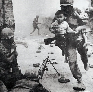 """The caption read, """"a Marine risks his life to save two babies."""""""
