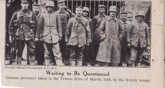 One of the prisoners is clearly a medic and four others are wearing the late war coal scuttle helmet.