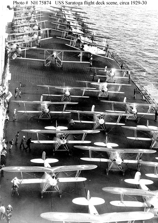 USS Saratoga (CV-3) Aircraft on the flight deck, preparing for launching, circa 1929-30. Planes in the foreground are Boeing F3B-1 fighters. In the background are fifteen Martin T4M-1 torpedo planes, of Torpedo Squadron Two (VT-2B). Courtesy of the Naval Historical Foundation, Washington, D.C. Collection of Admiral William V. Pratt. U.S. Naval History and Heritage Command Photograph.