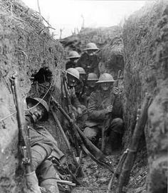 These soldiers appear to be British or Commonwealth. The trench is deep and well prepared. The Americans at Cantigny had little opportunity to dig so deep once they took the village.