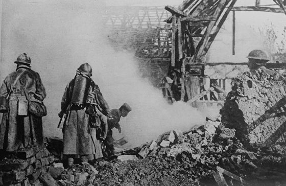 French flame throwers help clear Cantigny of German defenders.