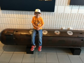 My grandson on a torpedo. If I remember right the sub had 14 torpedoes, 8 forward and 6 aft.